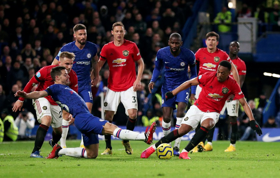 Manchester United's Anthony Martial in action with Chelsea's Cesar Azpilicueta. -Reuters