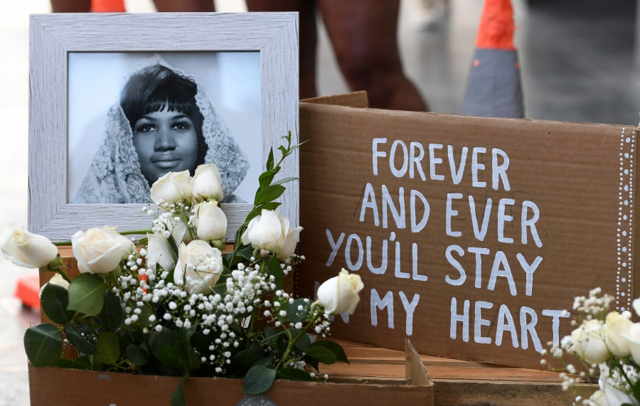 """Flowers and tributes are placed on the Star for Aretha Franklin on the Hollywood Walk of Fame in Hollywood, California, August 16, 2018, after the music icon, legendary singer and """"Queen of Soul"""" loved by millions whose history-making career spanned six decades, died on Thursday, August 16, 2018, her longtime publicist announced. - Franklin, who was 76, influenced generations of female singers with unforgettable hits including """"Respect"""" (1967), """"Natural Woman"""" (1968) and """"I Say a Little Prayer"""" (1968). She passed away at home in Detroit from advanced pancreatic cancer. AFP Photo"""