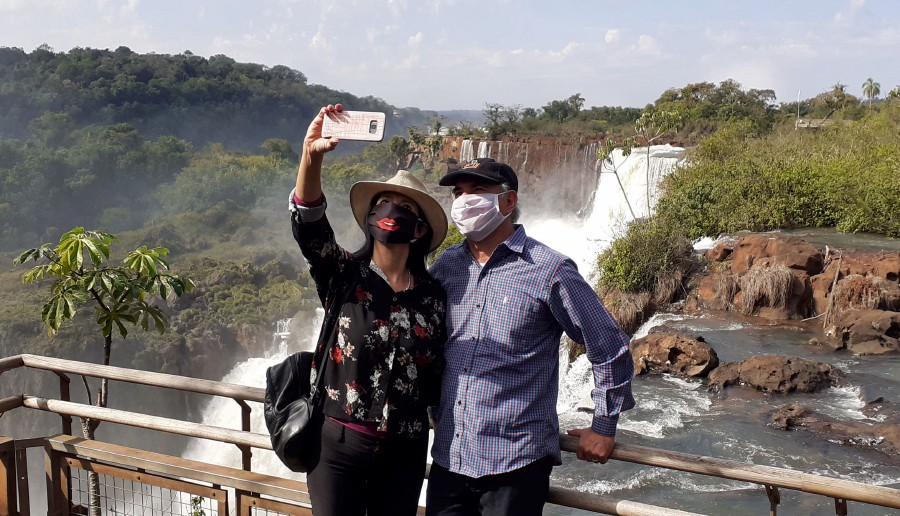 Handout picture released by Parques Nacionales showing residents of the nearby Argentine city of Puerto Iguazu visiting the Iguazu Falls at Iguazu National Park in northern Argentina, on July 11, 2020 during the COVID-19 novel coronavirus pandemic. -  AFP pic/Parques Nacionales