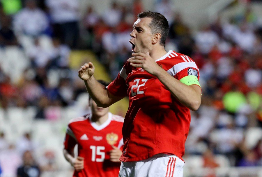 Russia's Artem Dzyuba celebrates after scoring a goal against Cyprus at the GSP stadium in Nicosia, Cyprus. - EPA