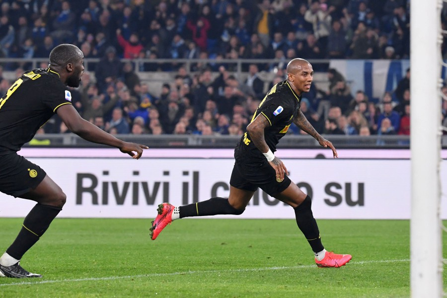 Inter Milan's Ashley Young (right) celebrates after opening the scoring against Lazio at the Olympic stadium in Rome. - AFP