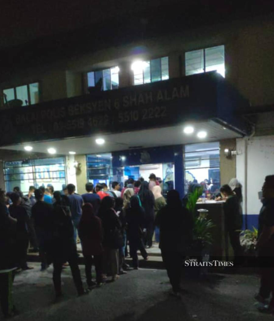 The New Straits Times obtained a photo of a long queue of people at a police station in Section 6, Shah Alam. It is not immediately known if the people in the image are applying to travel outside their respective states during the RMO. - NSTP/ Courtesy of NST reader
