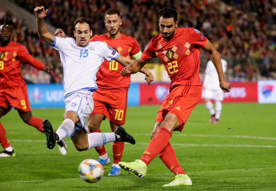 Cristian Brolli of San Marino (L) and Nacer Chadli of Belgium in action during the UEFA EURO 2020 Group I qualifying soccer match between Belgium and San Marino at the King Baudouin stadium in Brussels, Belgium, 10 October 2019. - EPA/STEPHANIE LECOCQ