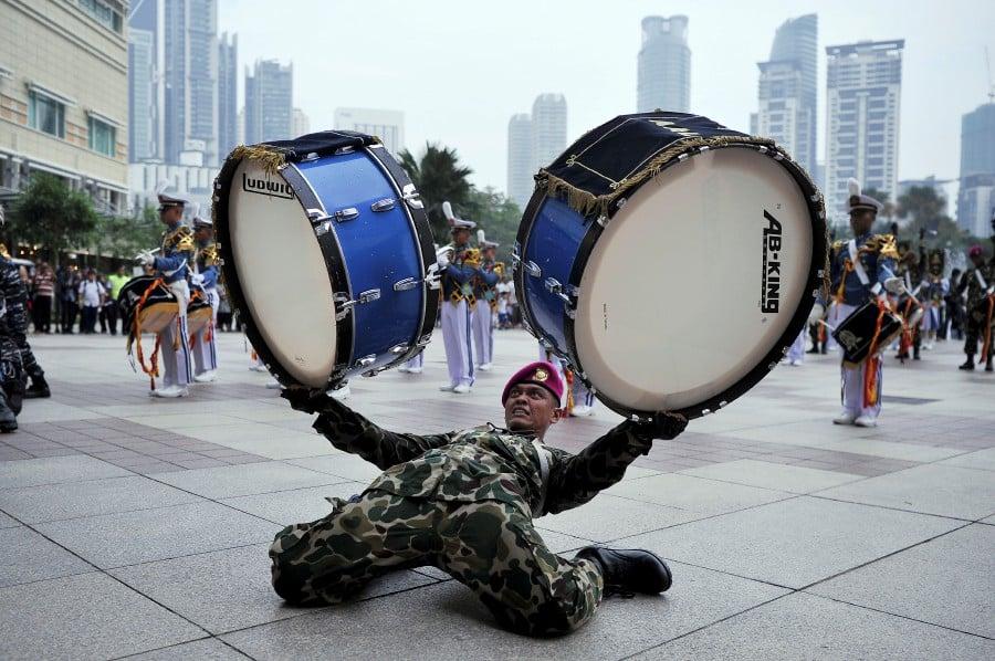 A bass drummer exhibiting his skills during the KRI Bima Suci 945's cadet marching band display at Suria KLCC in Kuala Lumpur. Image: Bernama