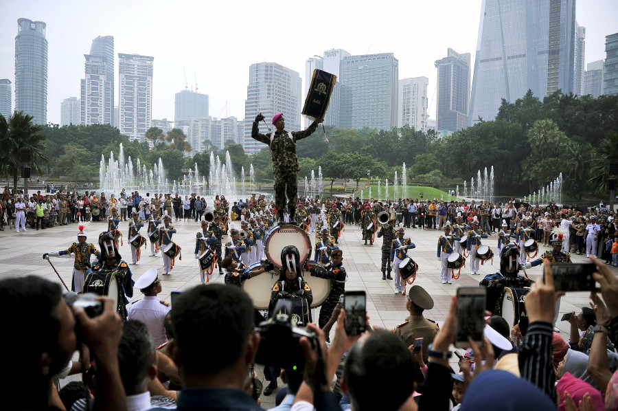 A KRI Bima Suci 945's cadet marching band member (centre, standing on drums) displays one of the highlights during their performance at Suria KLCC in Kuala Lumpur. Image: Bernama