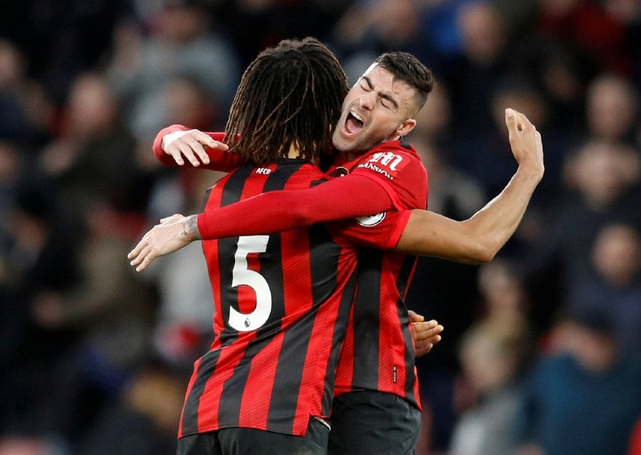 Bournemouth escapes relegation zone beating Aston Villa