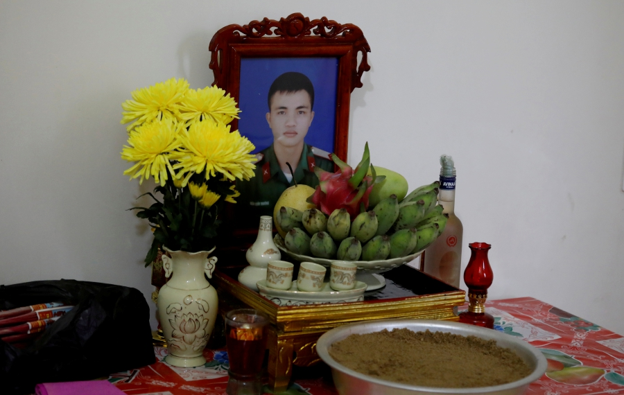 An image of Nguyen Dinh Tu, a Vietnamese suspected victim in a truck container in UK, is seen at a table at his home in Nghe An province, Vietnam October 26, 2019. REUTERS