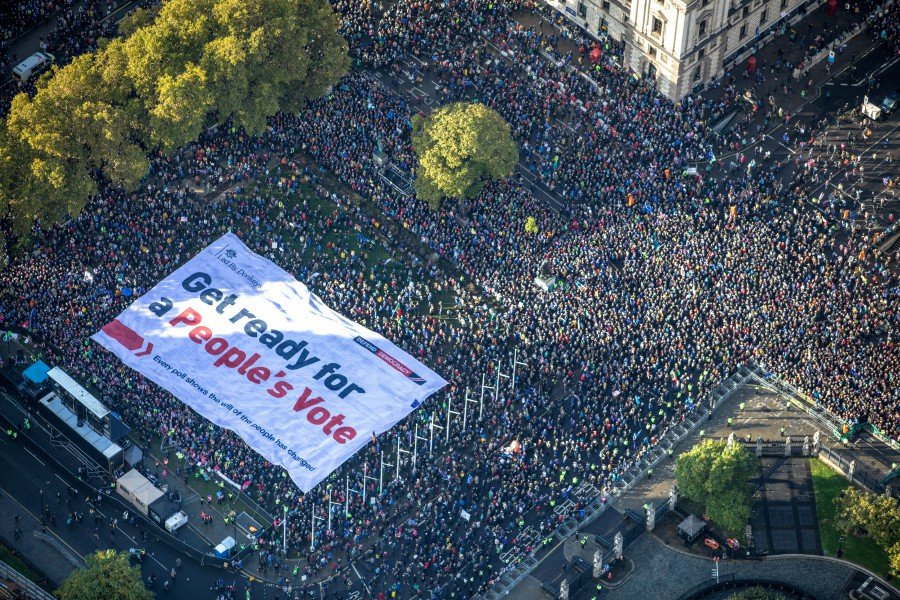 As lawmakers huddled inside the House of Commons on Saturday to debate Prime Minister Boris Johnson's Brexit deal, hundreds of thousands of protesters gathered outside the Palace of Westminster to demand that voters be given the final say on Brexit. -- Reuters photo