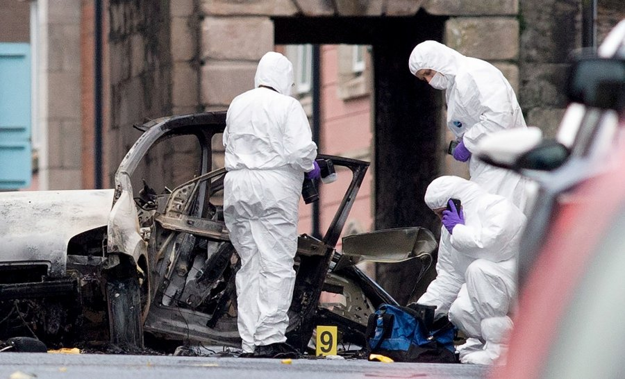 2675dad922ac8 Police forensic officers inspect the aftermath of a suspected car bomb  explosion in Derry, Northern Ireland, on January 20, 2019.