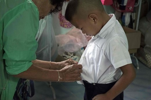 Thai village children stunted by poverty as parents leave for