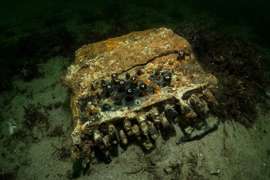 This Handout photo made available by the World Wildlife Fund (WWF) on December 4, 2020 shows the Enigma encryption machine discovered on November 11, 2020 in the Bay of Gelting in the Baltic Sea, northern Germany. -AFP pic/WWF/Submaris/ Florian Huber