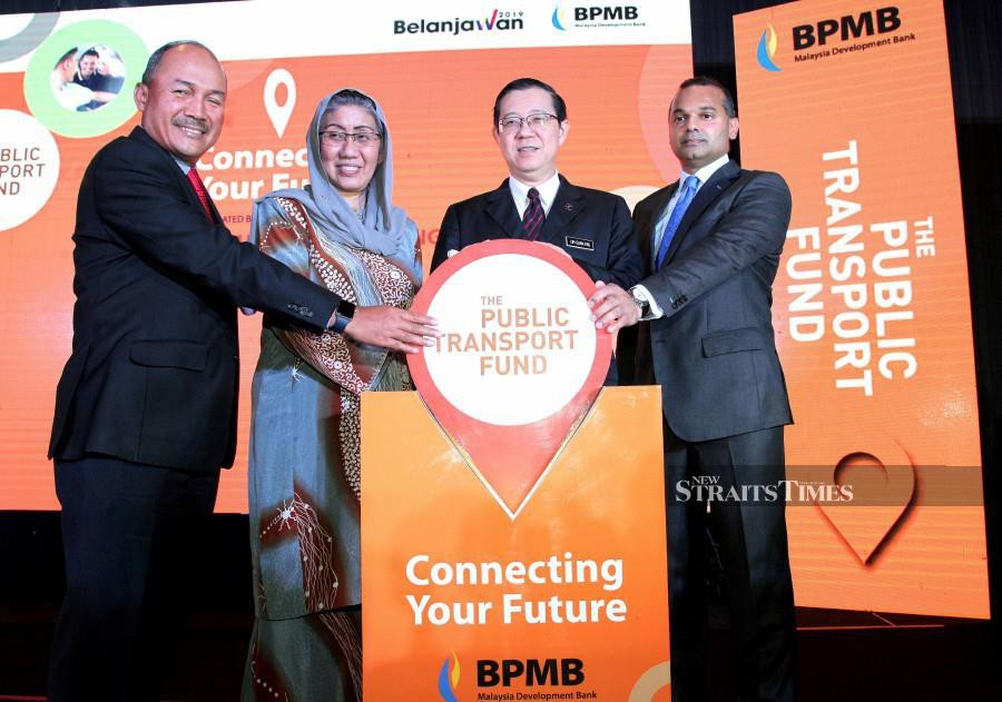 Finance Minister Lim Guan Eng (second from right), Bank Pembangunan Malaysia chairman Datuk Zaiton Mohd Hassan (second from left) and Bank Pembangunan president/group chief executive officer Arshad Mohamed Ismail (far right) at the launch of the bank's Transport Fund. NSTP photo by NIK HARIFF HASSAN