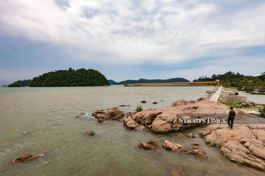 The view of Pulau Pelandung and Tanjung Penyabong's jetty from the island of Batu Ayam