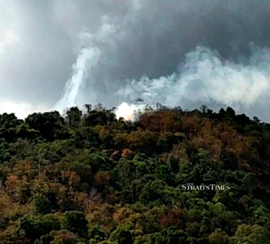 A fire broke out on a hill at Batu Gantung near here this afternoon, destroying 1.2ha of the forest. NSTP/Courtesy of NST readers