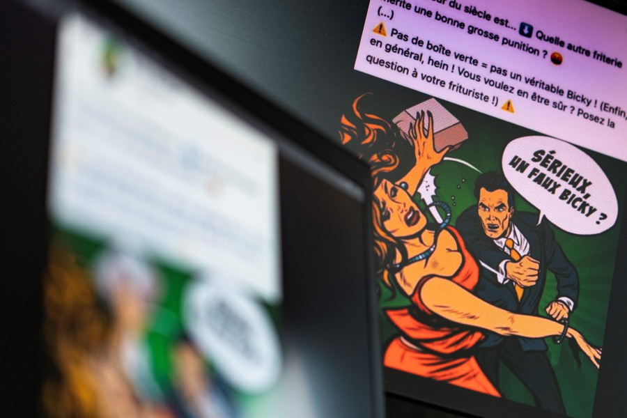 "A photo taken on October 9, shows an ad published on Facebook aimed to publicise the Belgian hamburger brand, Bicky Burger, and depicting a man in a suit swinging his fist to violently hit a buxom blonde woman carrying a fast-food container as he exclaims: ""Seriously, a fake Bicky?"". - Kenzo Tribouillard/AFP"