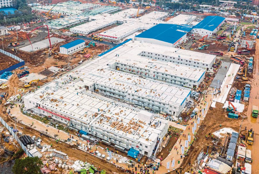 "This aerial photo taken on February 2, 2020 shows the Huoshenshan hospital, which means ""Fire God Mountain"", after handed over to China's army in Wuhan in China's central Hubei province. - China's army on February 2 was given control of a nearly-finished field hospital that will treat patients at the epicentre of a deadly virus epidemic that has severely strained medical facilities. AFP"