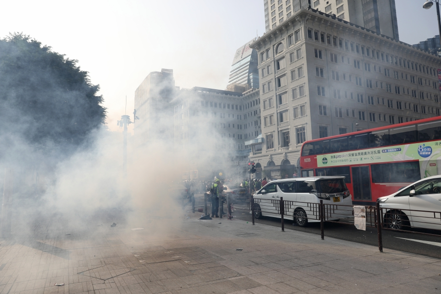 Tear gass floats through the air during a rally against police brutality in Hong Kong, China, 27 October 2019. Hong Kong has witnessed months of mass protests, which were originally triggered by a now withdrawn extradition bill, and have since turned into a wider pro-democracy movement. - EPA/JEROME FAVRE