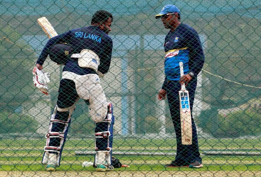 FILE PHOTO: Cricket - Sri Lanka v South Africa Ð Sri Lanka Team's Practice Session - Pallekele, Sri Lanka Ð August 4, 2018 Ð Sri Lanka's Upul Tharanga shows a shot next to coach Thilan Samaraweera during a practice session ahead of their third One Day International (ODI) cricket match against South Africa. REUTERS/Dinuka Liyanawatte/File Photo