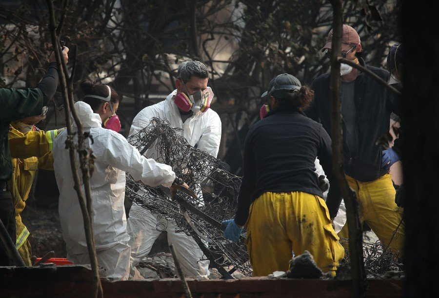 California presses search for fire victims, number of