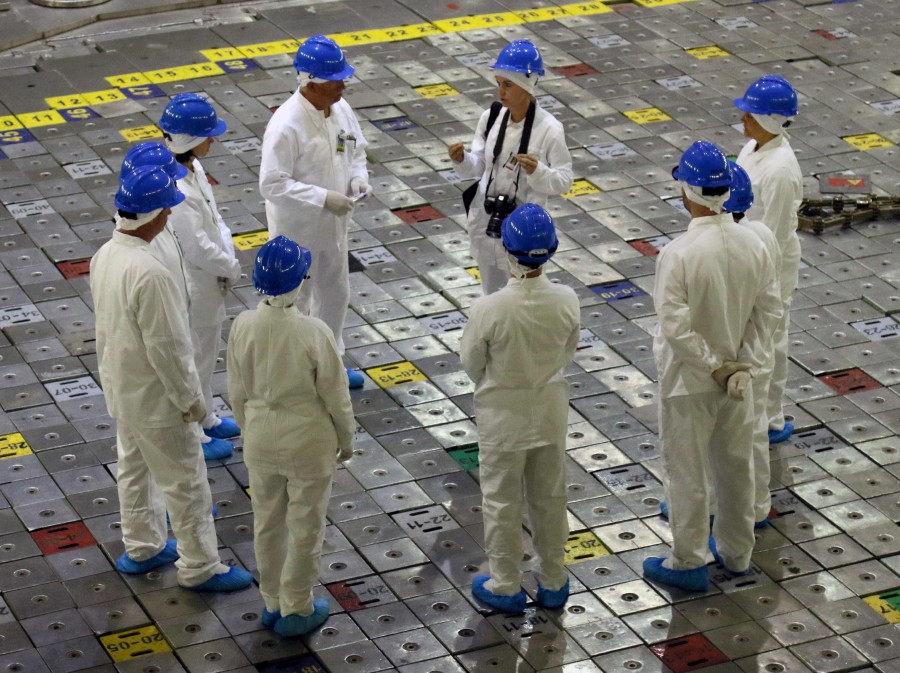 People take part in a guided tour inside the inoperative Ignalina nuclear power plant in Visaginas, Lithuania. - AFP