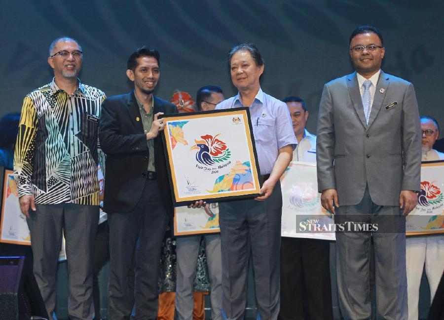 Tourism, Arts and Culture Minister Datuk Mohamaddin Ketapi (2nd from left) launched the official song of Visit Malaysia 2020 at Istana Budaya here, today. - NSTP/ASYRAF HAMZAH