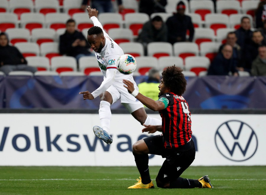 Olympique Lyonnais' Moussa Dembele in action with Nice's Dante. -Reuters