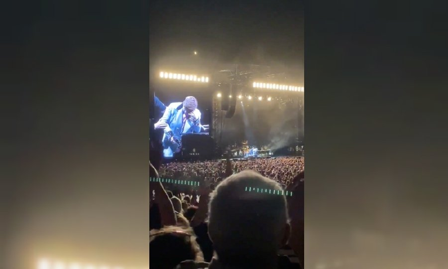Elton John is seen on a jumbotron, as he reacts after prematurely ending his show, at the Mount Smart Stadium in Auckland, New Zealand in this screen grab obtained from a social media video. -Sarah Parsons/via Reuters—