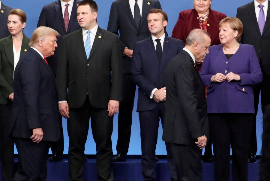 Germany's Chancellor Angela Merkel, Turkey's President President Tayyip Erdogan, U.S. President Donald Trump and France's President Emmanuel Macron during the photo opportunity at the NATO leaders summit in Watford. -Reuters