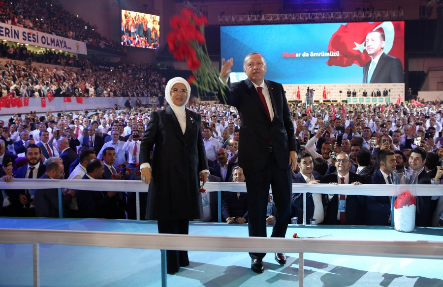 Erdogan vows turkey will not be cowed by us new straits times turkish president tayyip erdogan r and his wife emine erdogan l greet supporters ruling justice and development party akp during the sixth congress m4hsunfo