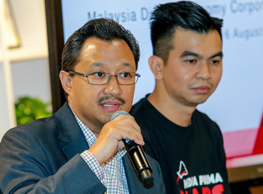 Media Prima Bhd group managing director Datuk Kamal Khalid (left) says the collaboration is expected to attract local and international players and developers. (NSTP Pic by ASYRAF HAMZAH)