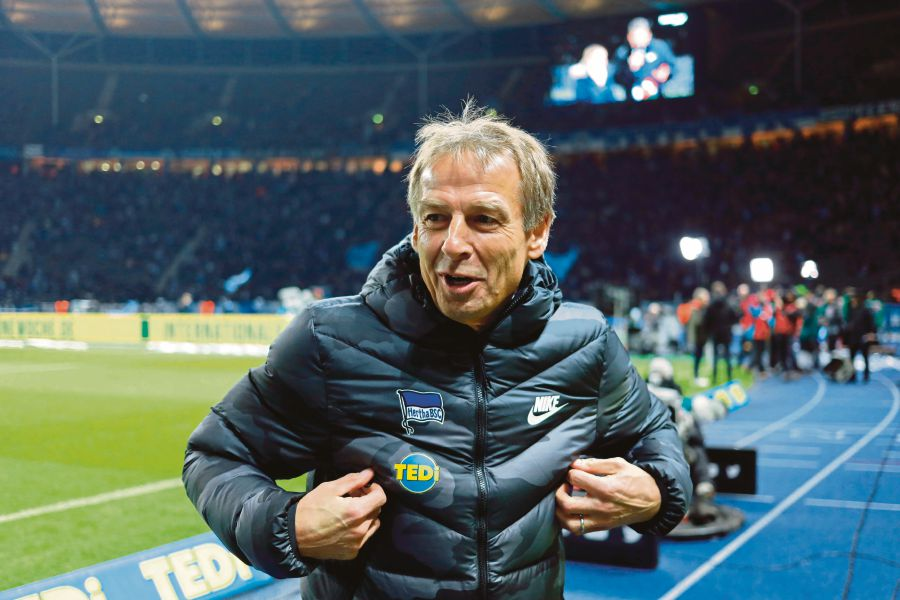 (FILES) In this file photo taken on December 21, 2019 Hertha Berlin's German head coach Jurgen Klinsmann reacts prior to the German first division Bundesliga football match Hertha Berlin v Borussia Moenchengladbach in Berlin. -AFP