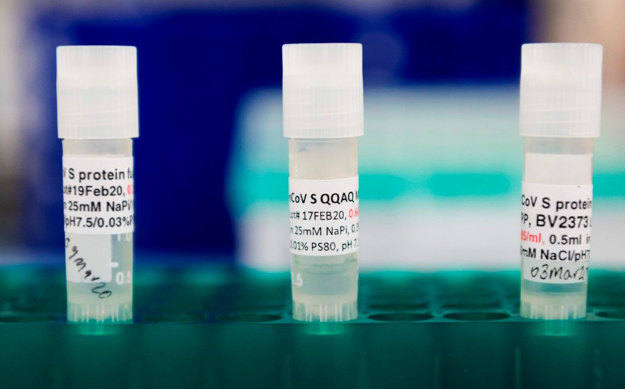 In this file photo three potential coronavirus, COVID-19, vaccines are kept in a tray at Novavax labs in Gaithersburg, Maryland. - AFP pic