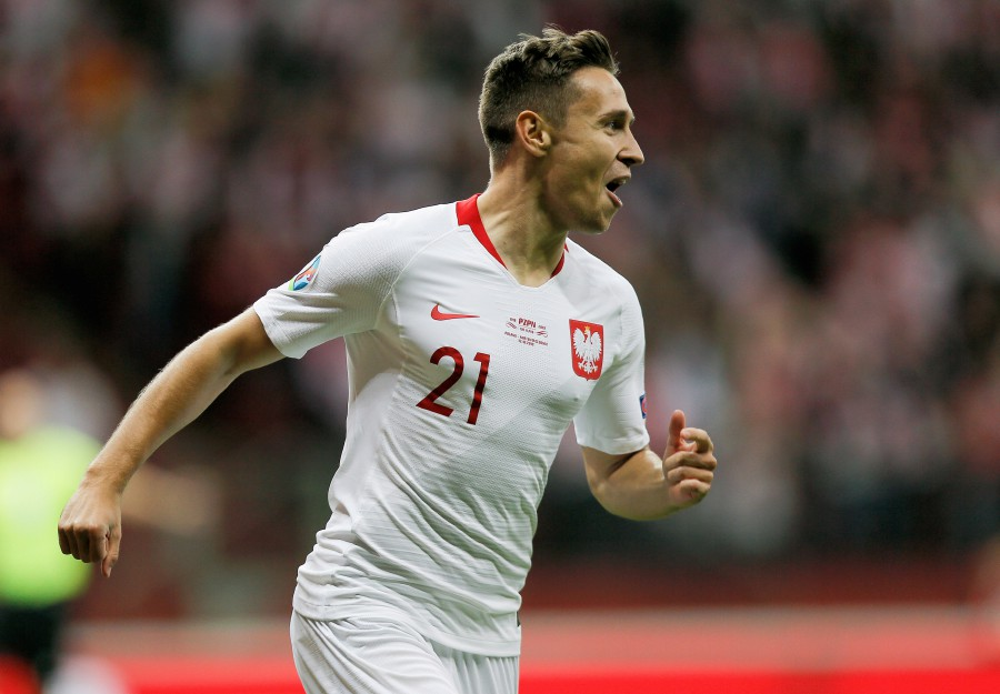 Poland's Przemyslaw Frankowski celebrates after scoring a goal during the UEFA EURO 2020 group G qualifying match between Poland and North Macedonia at PGE National stadium in Warsaw, Poland. - EPA