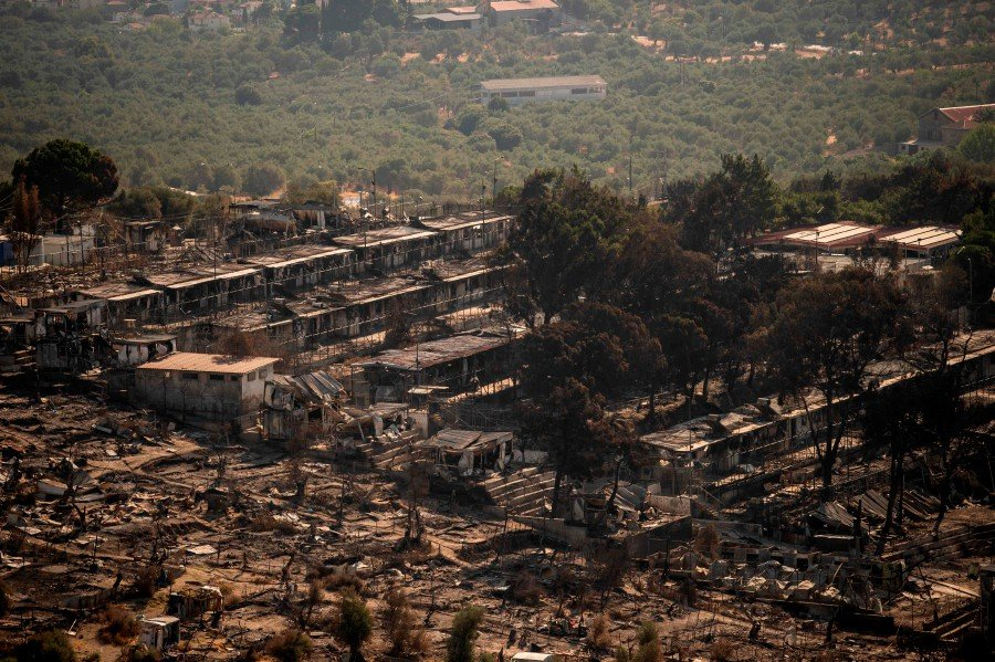 A picture taken on September 16, 2020, shows the remains of the burnt Moria migrant camp on the Greek Aegean island of Lesbos, after it was destroyed by a major fire on the night of September 8. - Six young Afghan men including two minors will face a prosecutor on Greece's Lesbos island on September 16 on suspicion of setting fires that destroyed Europe's largest migrant camp, leaving over 12,000 people homeless. (Photo by ANGELOS TZORTZINIS / AFP)