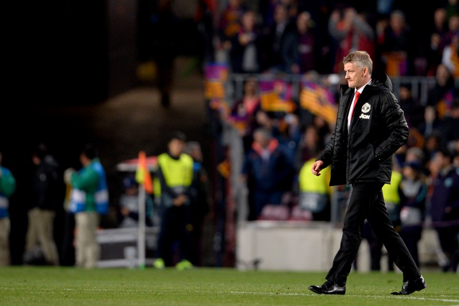 ecc597be2f796 Manchester United s Norwegian coach Ole Gunnar Solskjaer walks on the pitch  at the end of the UEFA Champions League quarter-final second leg match  against ...