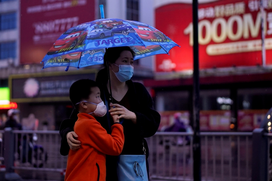 People wearing face masks walk in Jingzhou, after the lockdown was eased in Hubei province, the epicenter of China's coronavirus disease (COVID-19) outbreak. -REUTERS pic