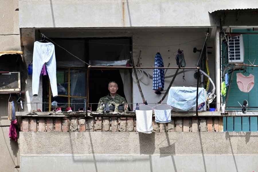 An elderly man stands on a balcony at a residential compound in Wuhan, the epicentre of the novel coronavirus disease (COVID-19) outbreak, Hubei province, China. -REUTERS pic