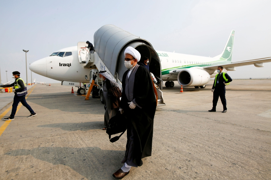 A cleric man wears a protective mask amid concerns over the coronavirus (COVID-19) spread, at Najaf airport in the holy city of Najaf upon his arrival from Iran, Iraq. -REUTERS pic