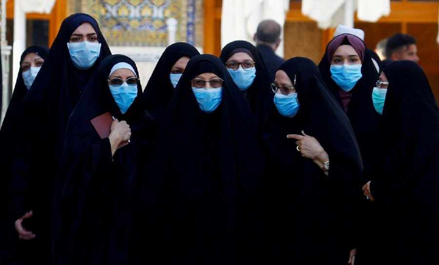 Muslims women wear protective face masks at Imam Ali Shrine, following an outbreak of coronavirus, in the holy city of Najaf, Iraq. -REUTERS pic