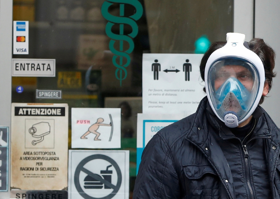A man wears a diving mask during the coronavirus disease (COVID-19) outbreak in Rome, Italy. -REUTERS pic