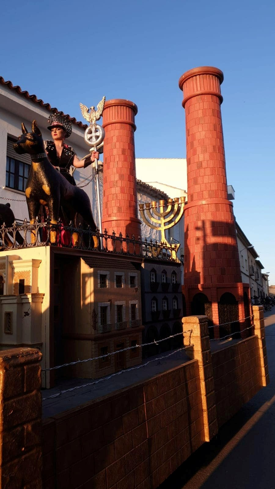 A woman is seen standing on a carnival float depicting Third Reich eagle symbol, Menorah candle holder and crematorium chimneys, during a carnival parade in Campo De Criptana, Ciudad Real Province, Spain February 24, 2020 in this picture obtained from social media. DIMAS DONATE/via REUTERS