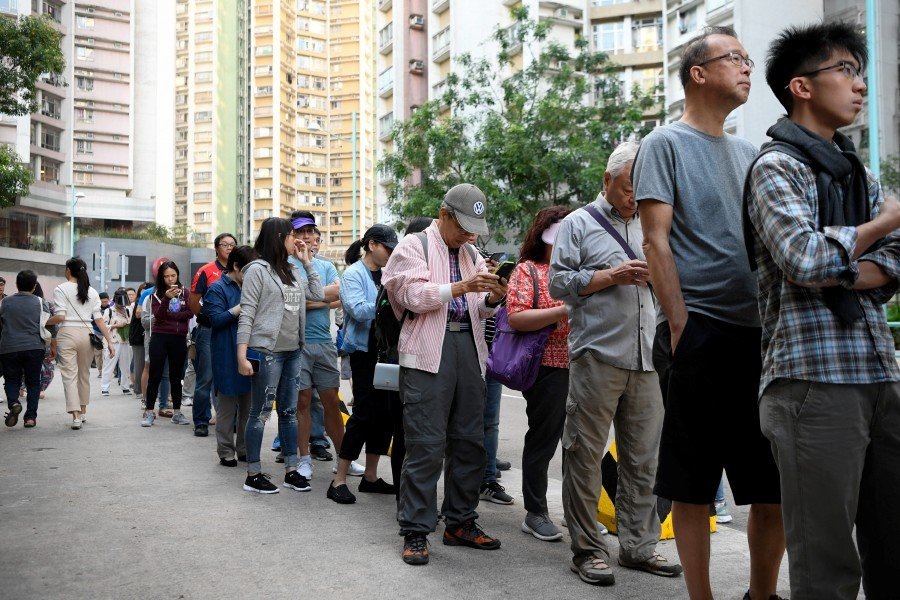 Hong Kong democracy camp heads for stunning polls win