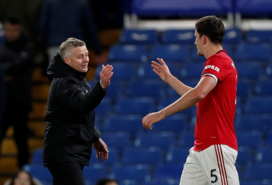 Manchester United manager Ole Gunnar Solskjaer celebrates with Harry Maguire after the match. -Reuters