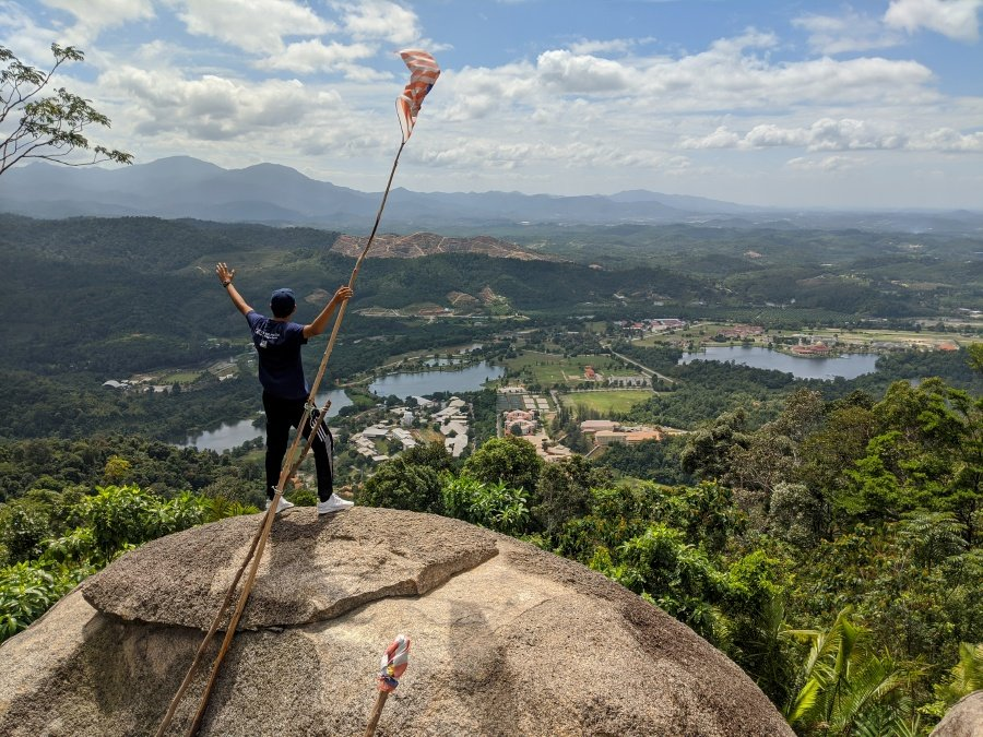 Hikers are rewarded with a magnificent view at the peak of Bukit Batu Pahat