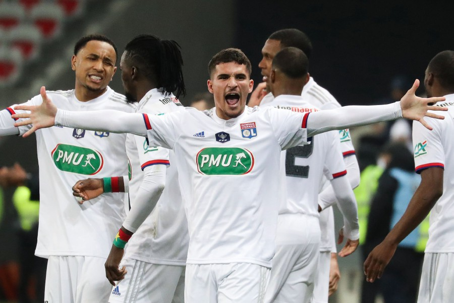 Lyon's Houssem Aouar (centre) celebrates after scoring a goal against Nice at the Allianz Riviera stadium in Nice. -AFP
