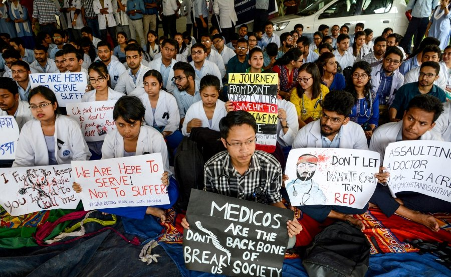 Indian students and doctors of Guwahati Medical College Hospital (GMCH) hold posters as they stage a silent protest during the nationwide strike held after the recent assault in Kolkata on an intern doctor, in Guwahati on June 17, 2019. AFP Photo