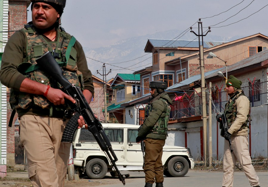 Indian security forces stand guard at the site of a grenade explosion in Srinagar, Kashmir. India applied a sanction on Malaysia's palm oil exports after Prime Minister Tun Dr Mahathir Mohamad commented on the withdrawal of Kashmir's autonomy. - Reuters file pic