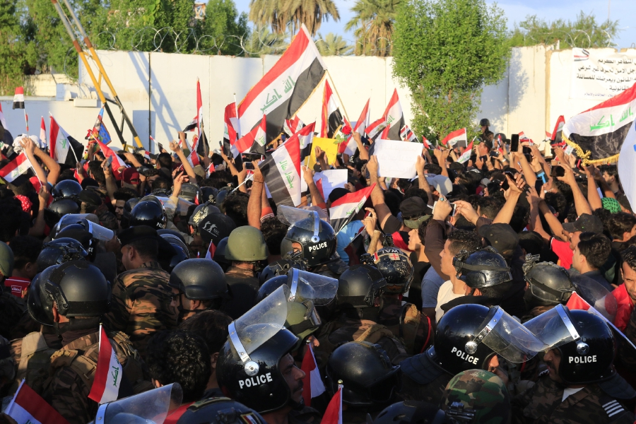 raqi protesters chant slogans and carry the Iraqi national flag during a demonstration in Karbala, southern Iraq, 25 October 2019. Thousands of protesters in Baghdad and southern Iraqi cities staged new protests against the Iraqi government corruption and poor government services. At least 20 protesters were killed and dozens others were wounded during clashes with riot police forces in Baghdad and Nasriyah city southern Iraq. EPA/FURQAN AL-AARAJI