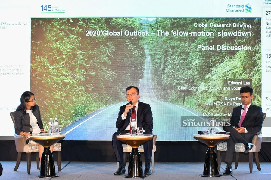 (From left): Standard Chartered Head of Thematic Research Madhur Jha, Chief Economist of Asean and South Asia Edward Lee and Head of ASA Foreing Exchange Research Divya Devesh during a the Global Research Briefing 2020 here in Kuala Lumpur today.