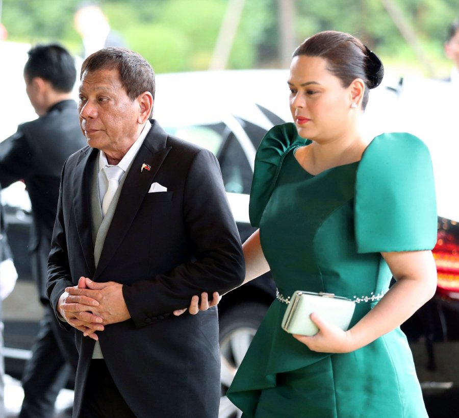 Philippine President Rodrigo Duterte (L) and his daughter Sara Duterte arrive at the Imperial Palace in Tokyo, Japan, 22 October 2019. Some 2,000 guests from Japan and over 180 countries are attending the enthronement ceremony. EPA/JIJI PRESS